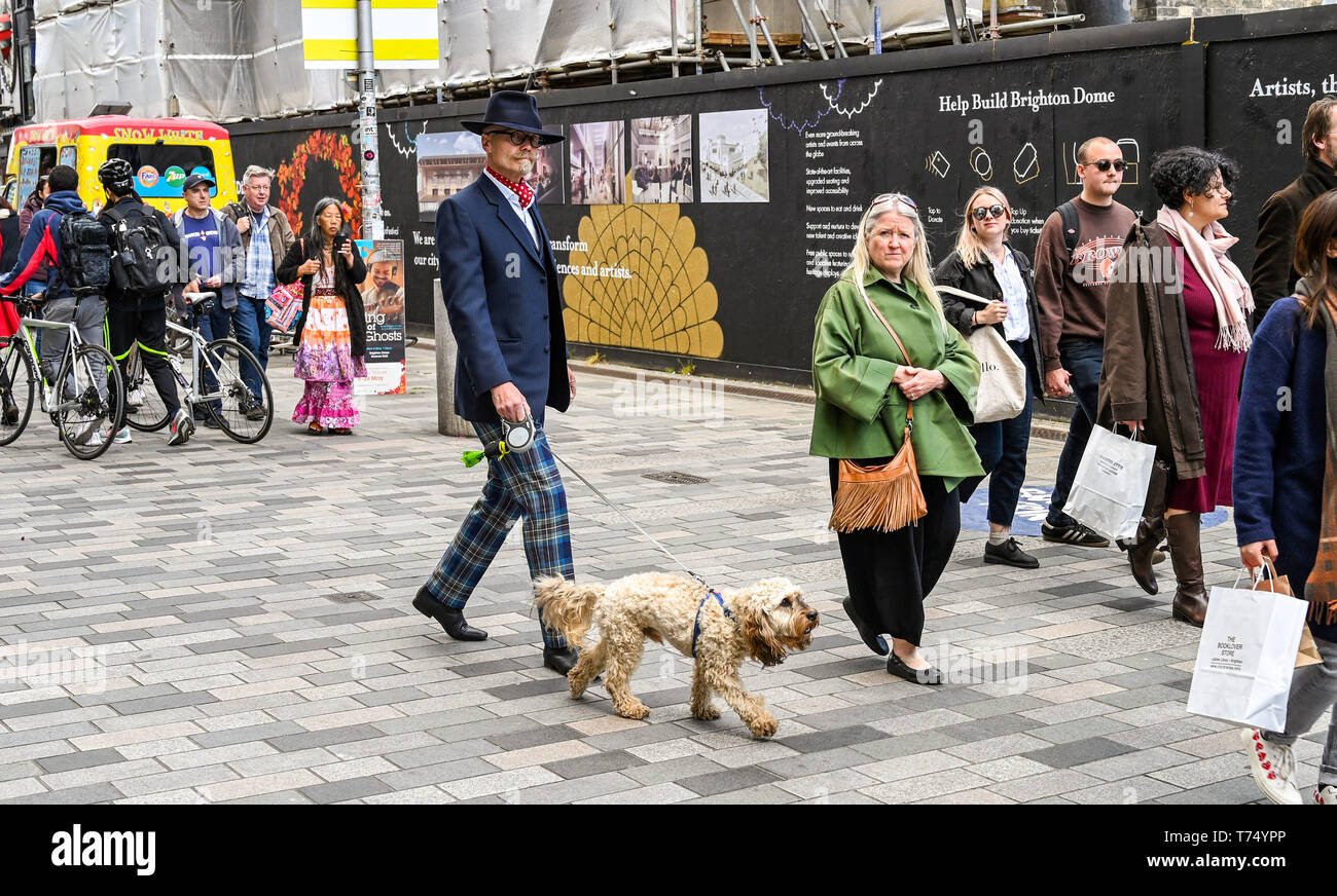 Brighton UK 4th May 2019 - Fashionable visitors enjoy the sunny but cool weather in Brighton today with unsettled conditions forecast for the UK over the next few days. Credit: Simon Dack / Alamy Live News Stock Photo