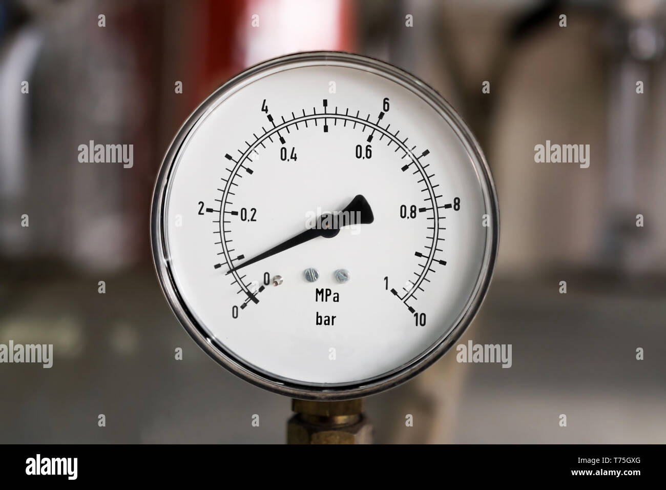Metal industrial pressure gauge - Stock Image