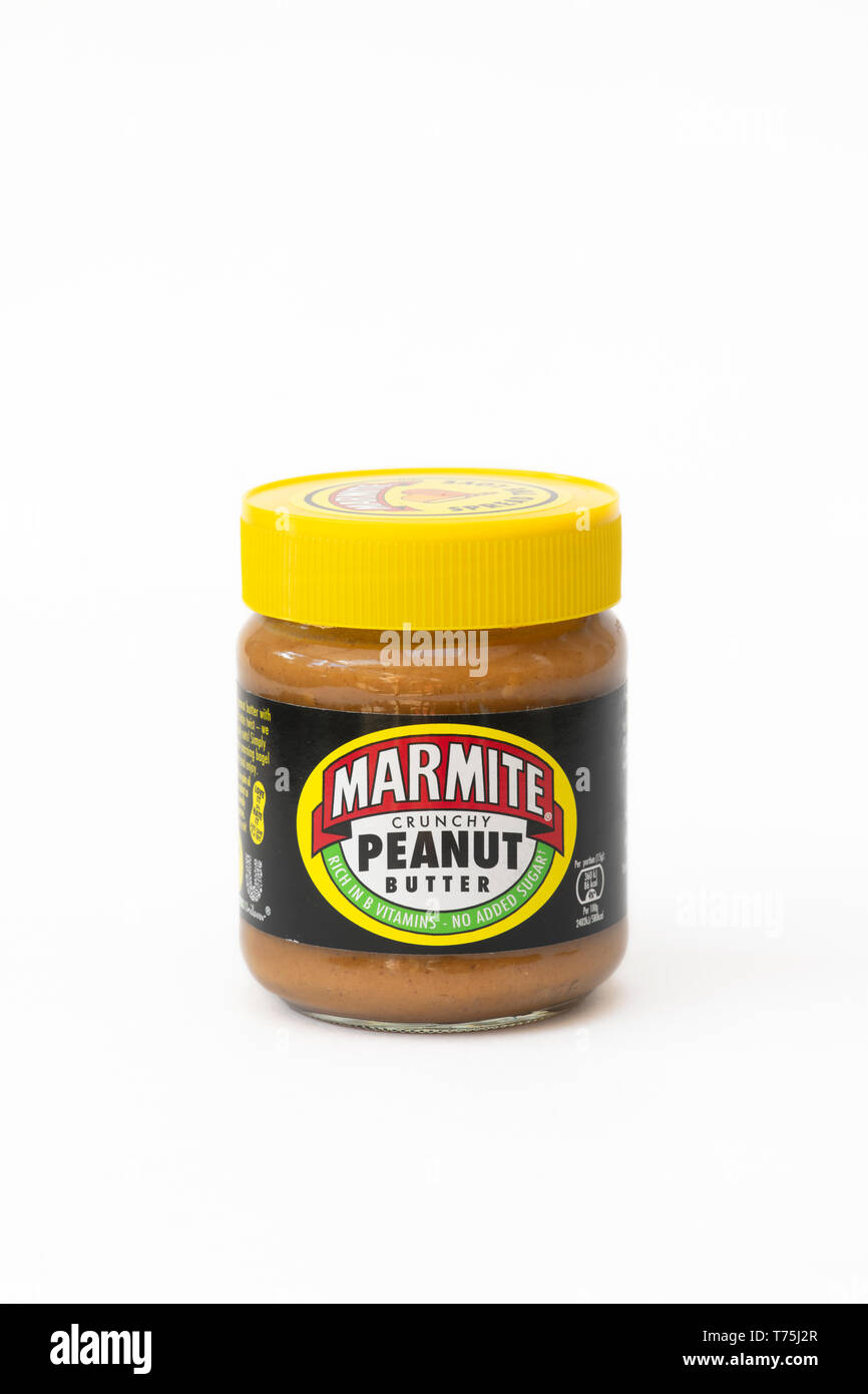 Marmite crunchy peanut butter jar on a white background - Stock Image