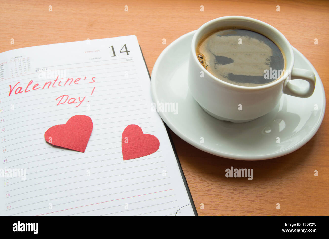 The concept of celebrating Valentine's Day, Cup of coffee, diaries, hearts - Stock Image