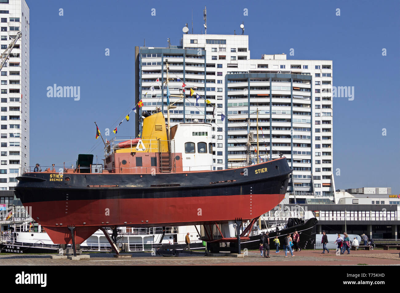 tugboat Stier at the museum-harbour and Columbus Center, Bremerhaven, Bremen, Germany - Stock Image