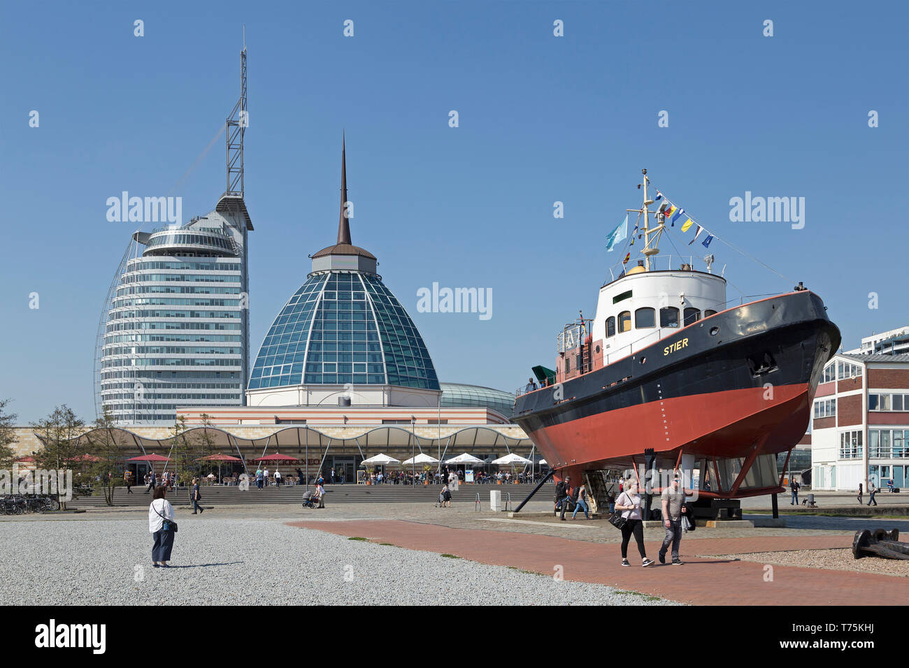 ATLANTIC Hotel Sail City, Mediterraneo and tugboat Stier at the museum-harbour, Bremerhaven, Bremen, Germany - Stock Image