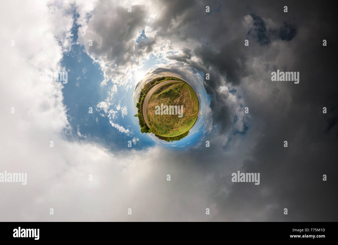 Little planet spherical panorama 360 degrees. Spherical aerial view in field in nice day with awesome clouds. Curvature of space. light vs darkness - Stock Image
