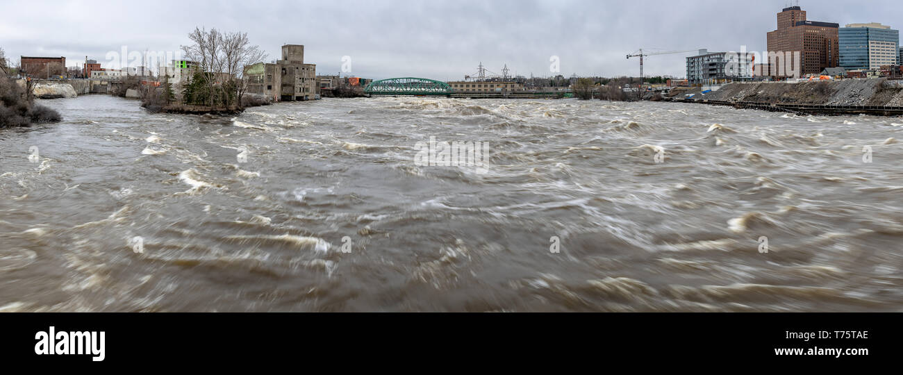 A panoramic view of the historic flooding of the Ottawa River in April 2019 as taken from the Portage Bridge near Parliament Hill in Ottawa, Ontario. - Stock Image