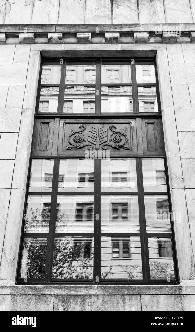 The federal courthouse is reflected in the windows of the City Building, in Asheville, NC, USA - Stock Image