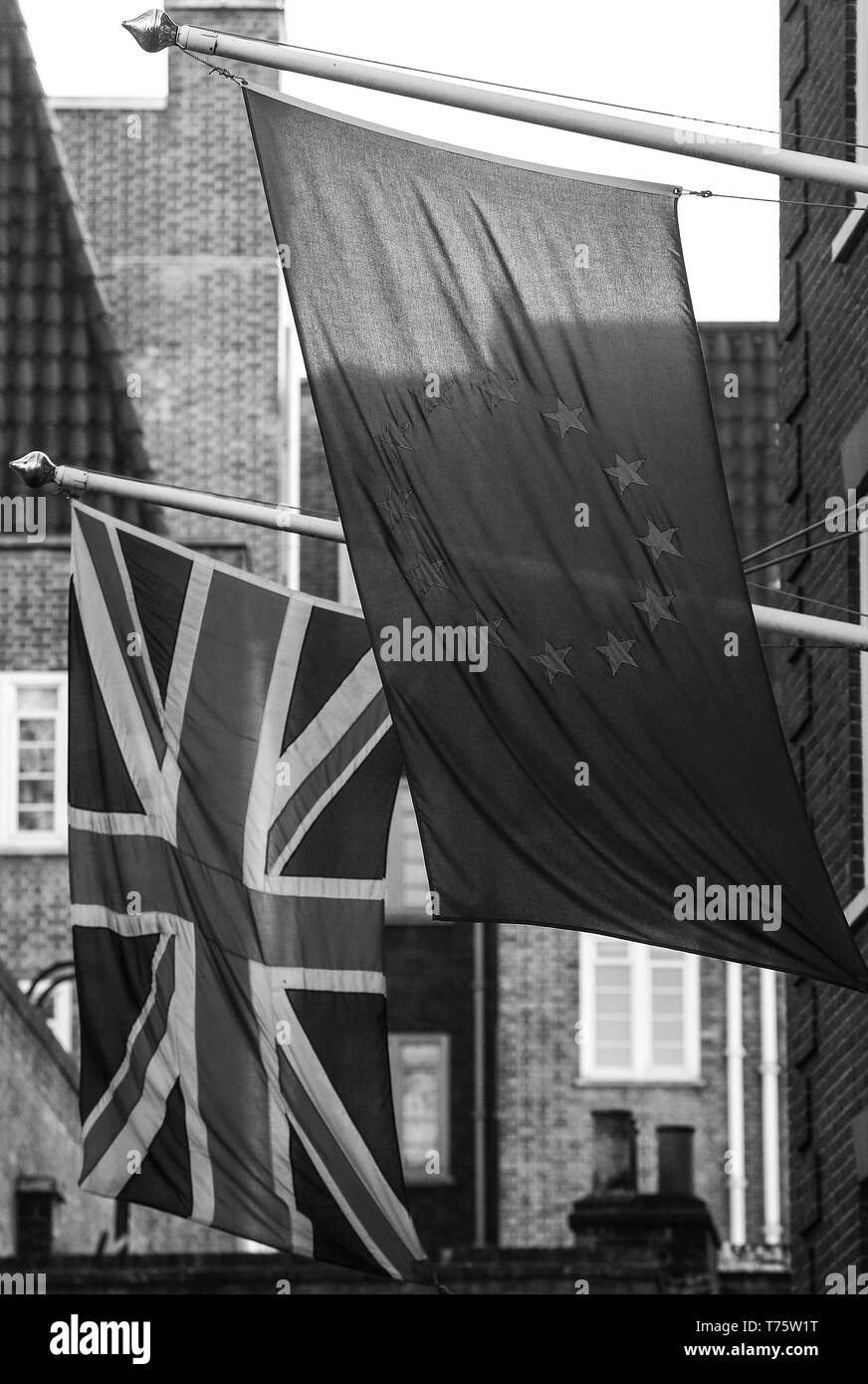 A British Union flag, AKA Union Jack, flies with the European Union (EU) flag, are seen outside Europa House. London, U.K. - Stock Image