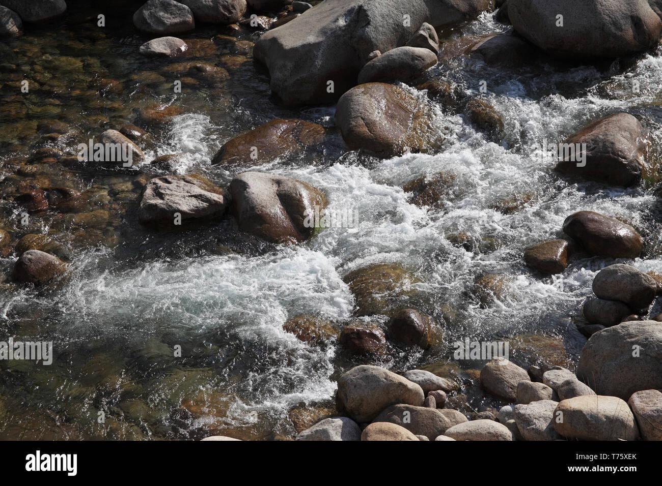 Rocks in the Solenzara River Parc Naturel Regional de Corse Corsica France Stock Photo