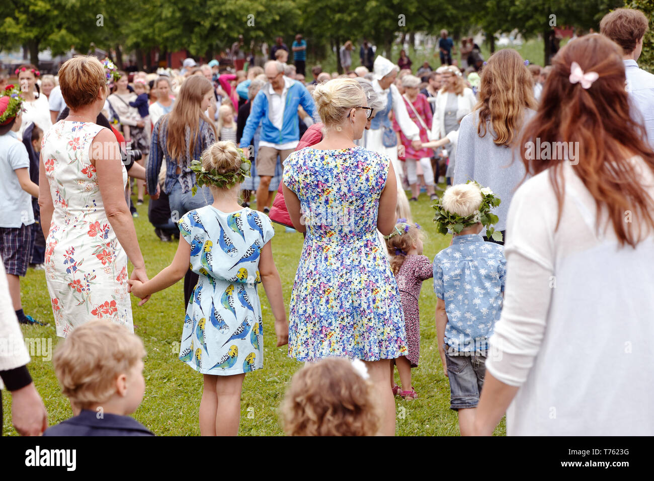 Mariefred, Sweden - June 24, 2016: People participate in the public traditional celebration of the midsummer holiday dancing around the midsummer pole Stock Photo