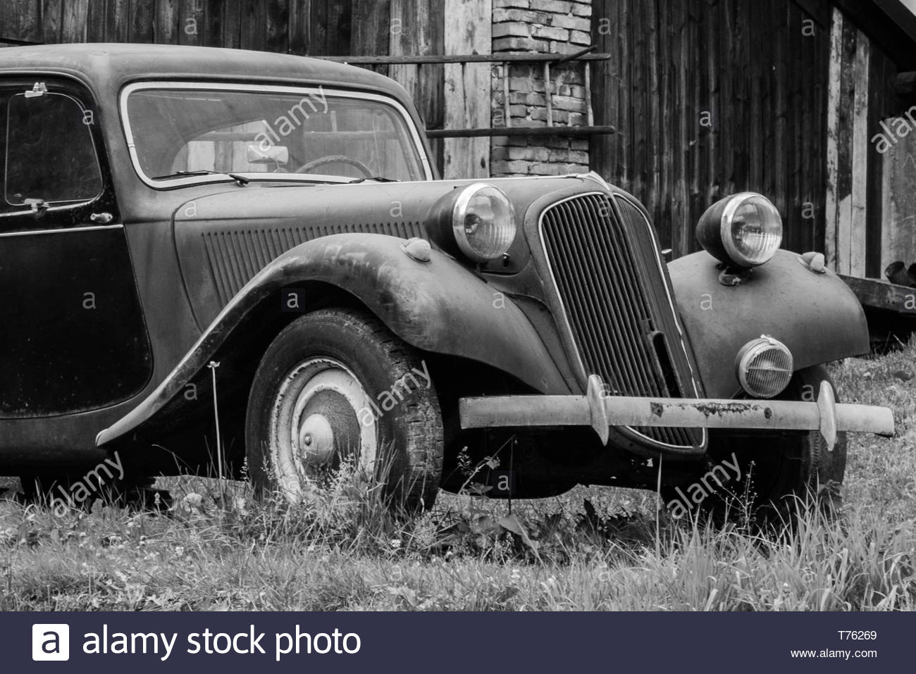 Old car, a wreck, an abandoned car, a historic car - Stock Image