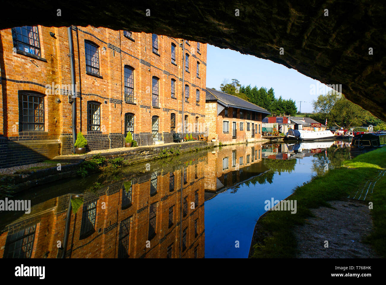 Looking along the Grand Union Canal from under tunnel at Blisworth. - Stock Image