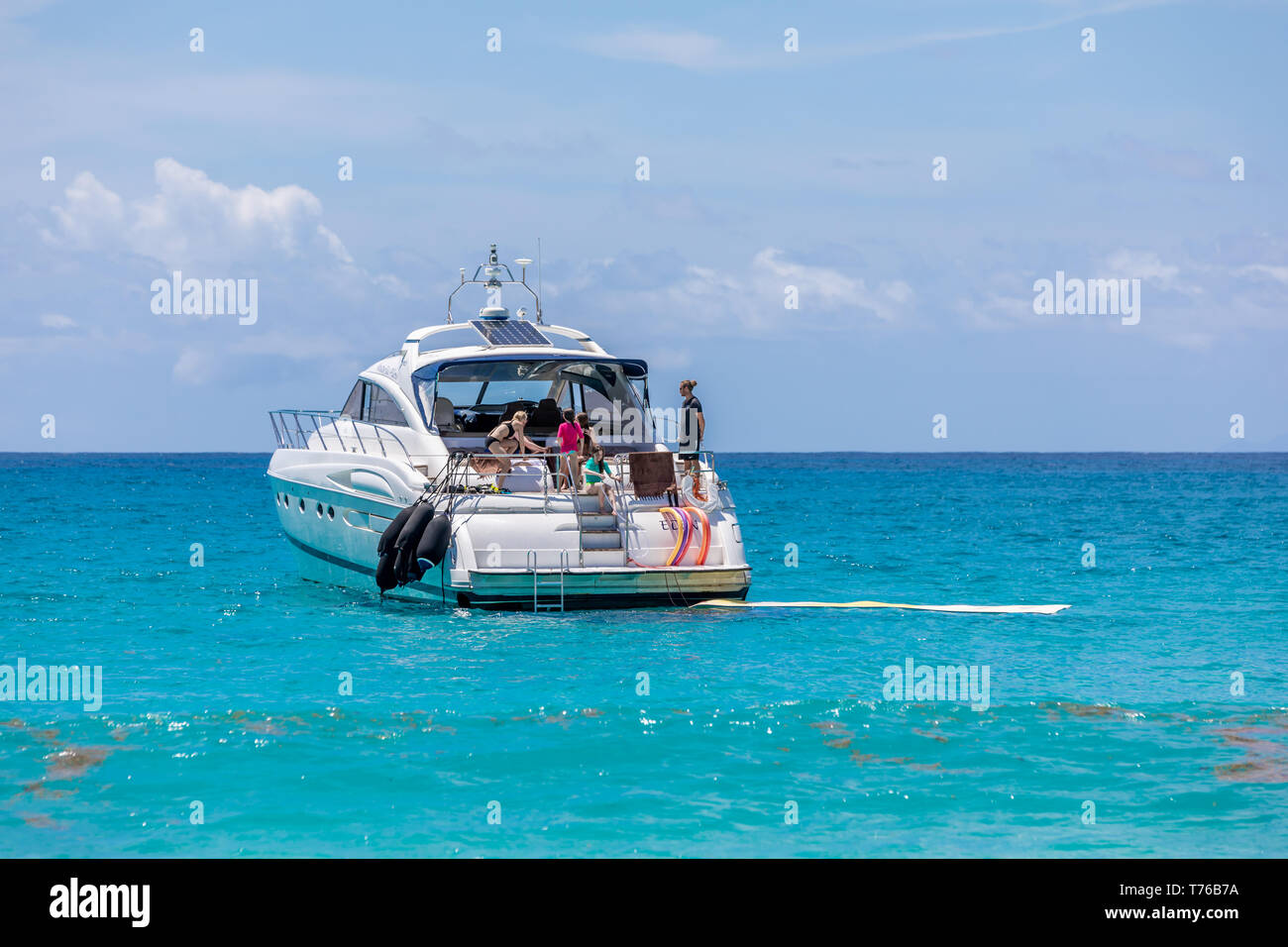 people on a boat at Saline Beach in St Bart's enjoying the day Stock Photo
