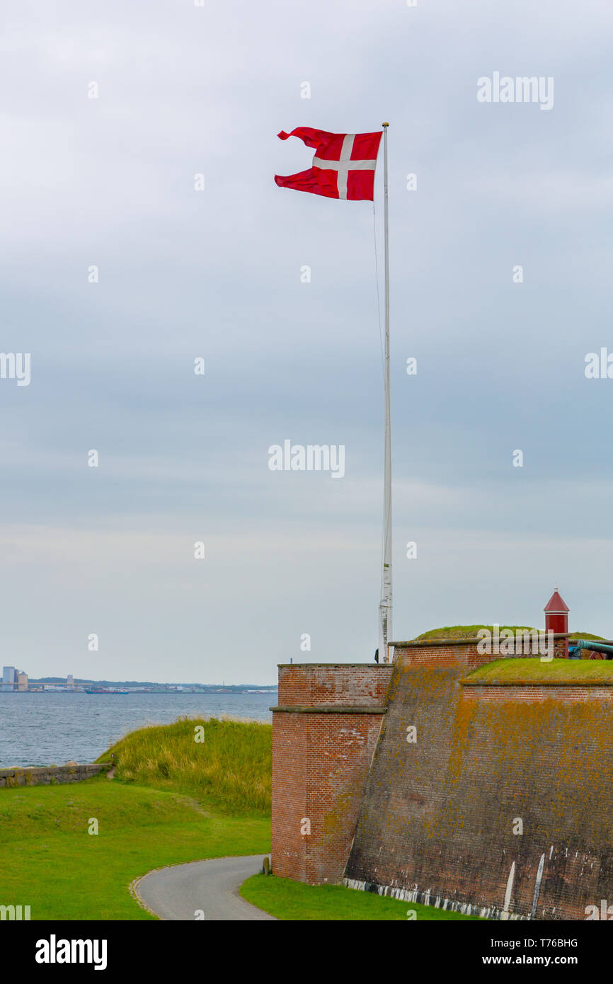Danish flag near Kronborg castle in Denmark - Stock Image