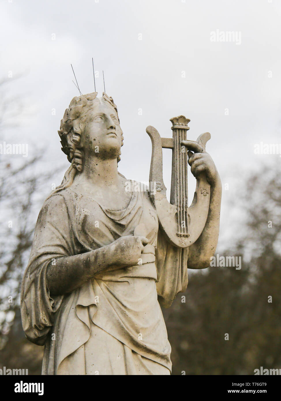 Statue of Calliope, in Greek Mythology the muse who presides over eloquence and epic poetry, holding a lyre in the Jardin de Luxembourg, Paris, France Stock Photo