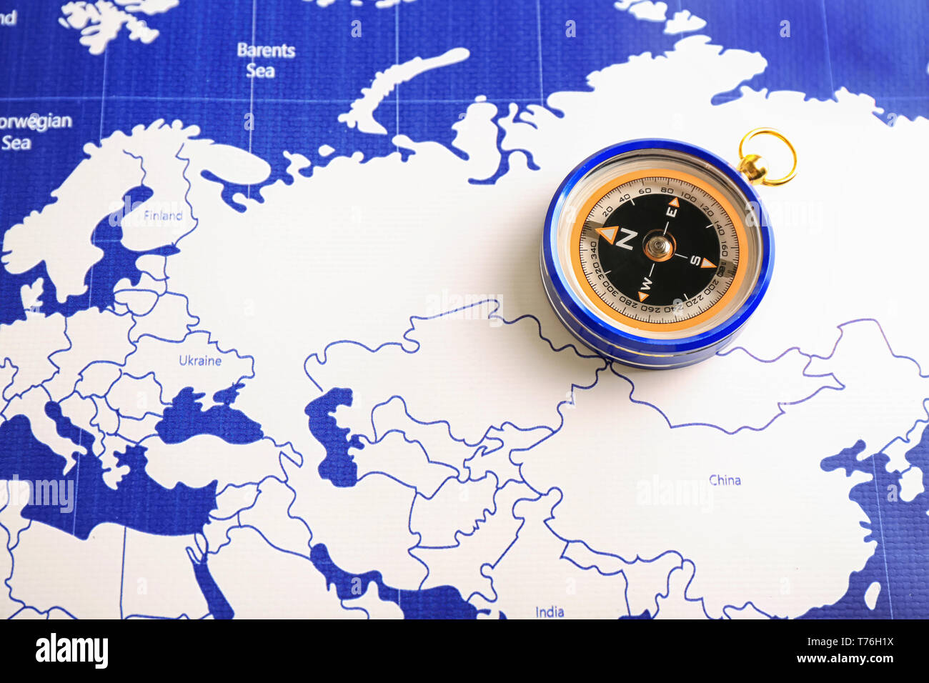 Compass on world map Stock Photo: 245392838 - Alamy