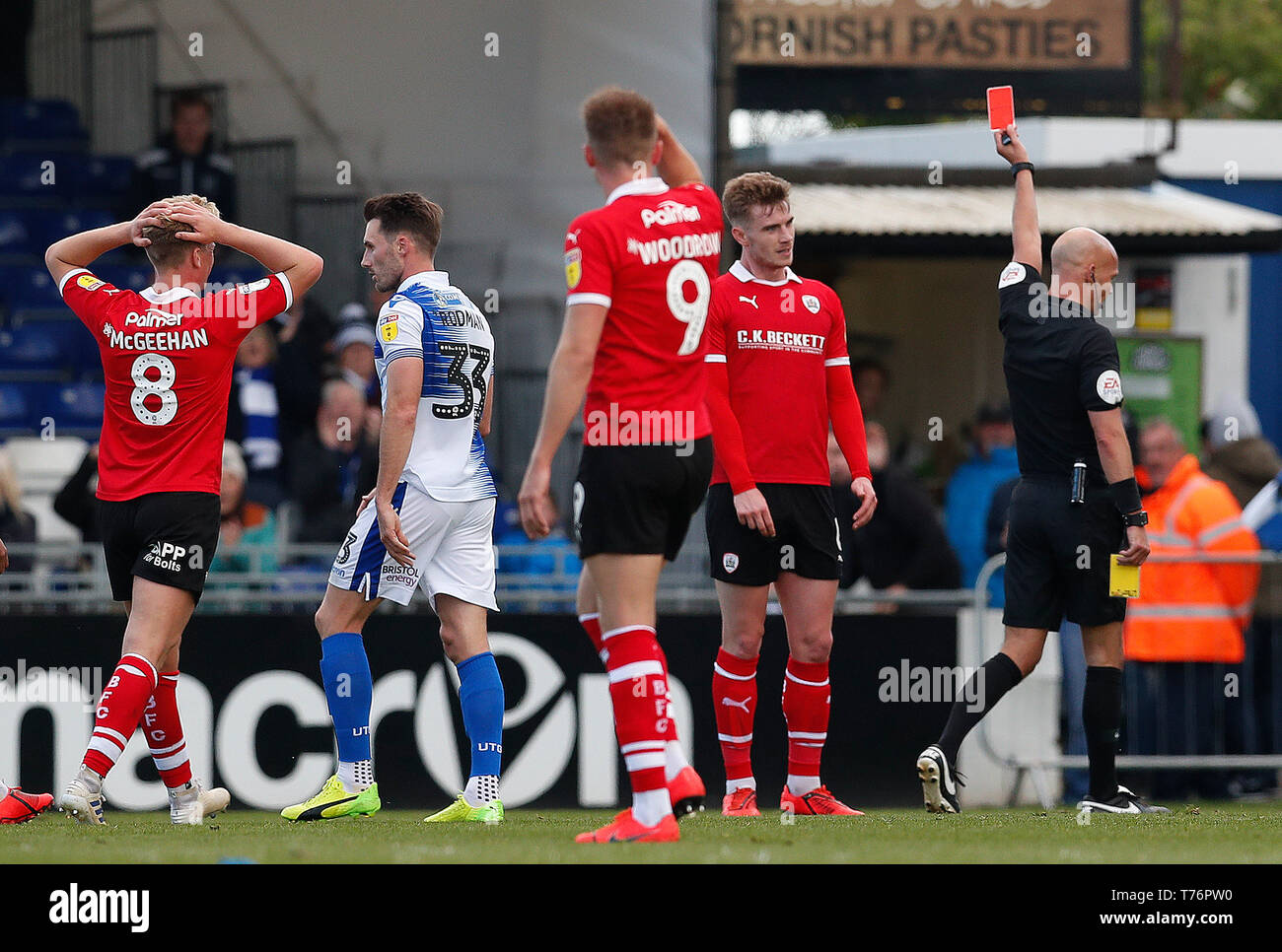 Barnsley's Liam Lindsay (right) is sent off by referee Darren Drysdale during the Sky Bet League One match against Bristol Rovers at Memorial Stadium, Bristol. - Stock Image
