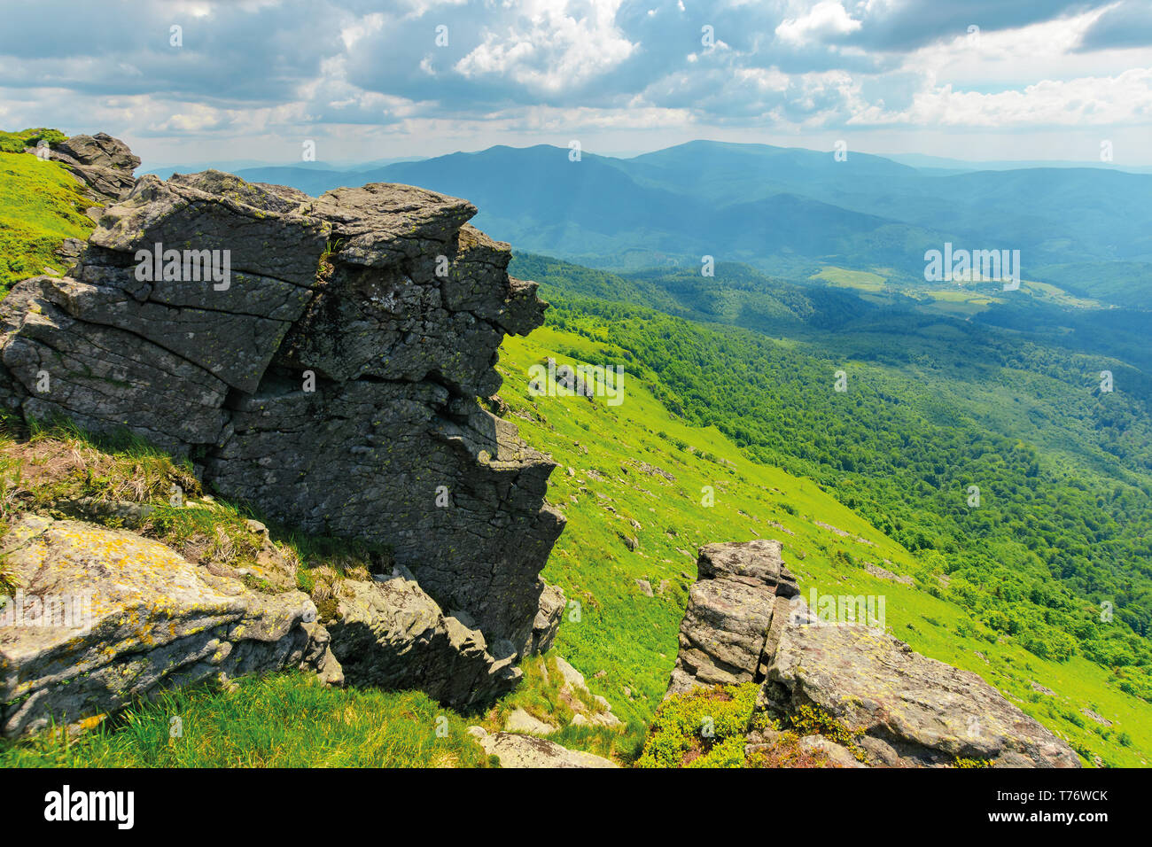 huge rocky formations on the grassy hills. beautiful mountain landscape in late summer on a cloudy day. location Runa mountain, Ukraine - Stock Image