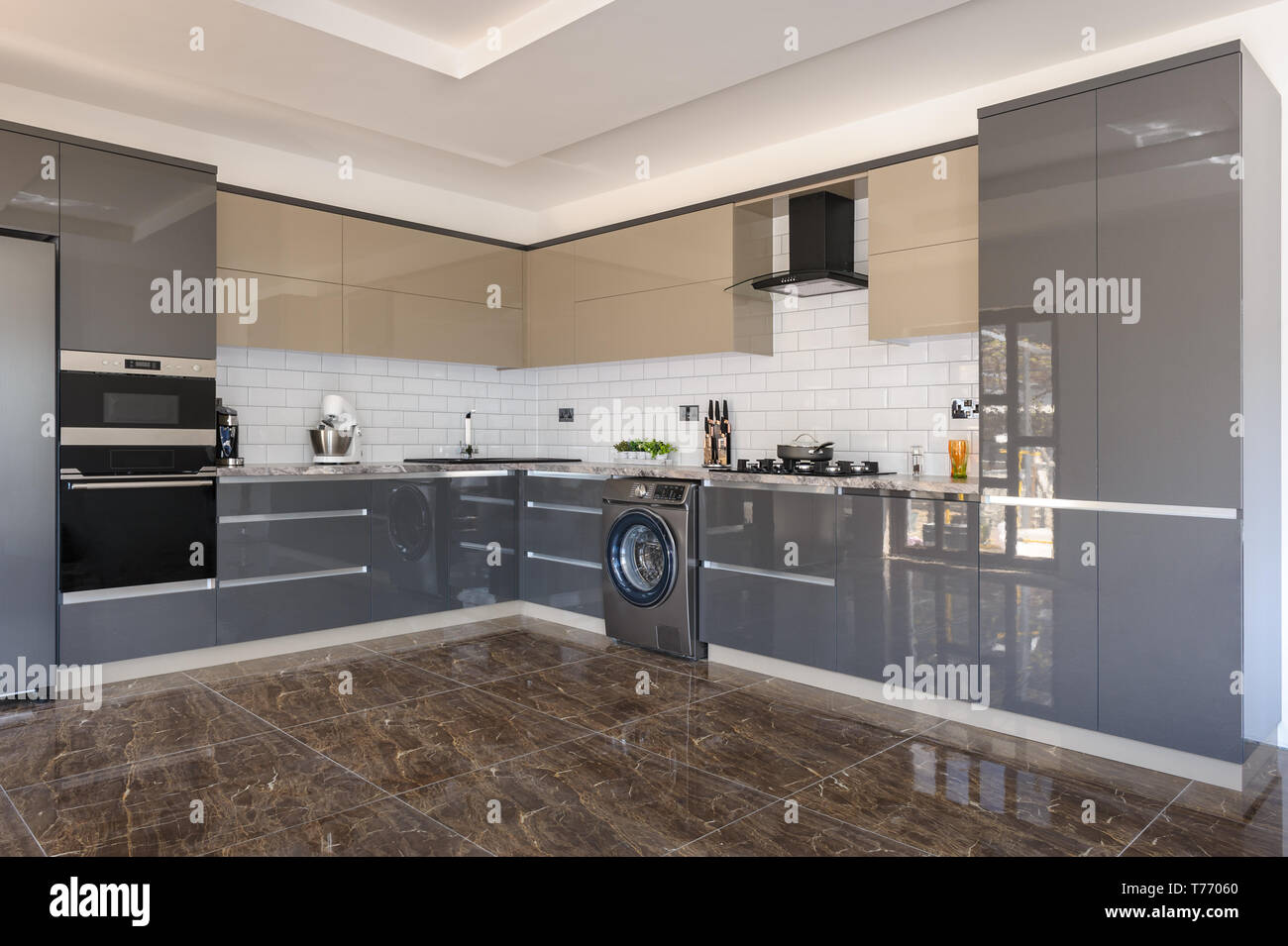 Spacious Luxury Well Designed Modern Grey Beige And White Kitchen With Marble Tiles Floor Stock Photo Alamy