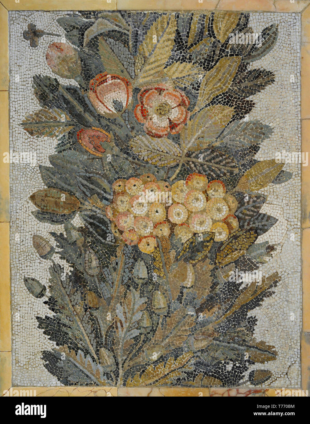 Roman floral mosaic. 1st century AD. Limestone and vitreous paste. From Italy. National Archaeological Museum. Madrid. Spain. - Stock Image