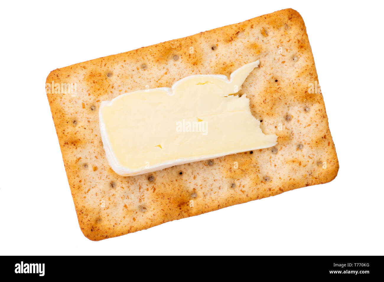 Cheese cracker with a slice of brie viewed from overhead. Sourdough crackers for a quick snack, UK. Cut out or isolated on a white background - Stock Image