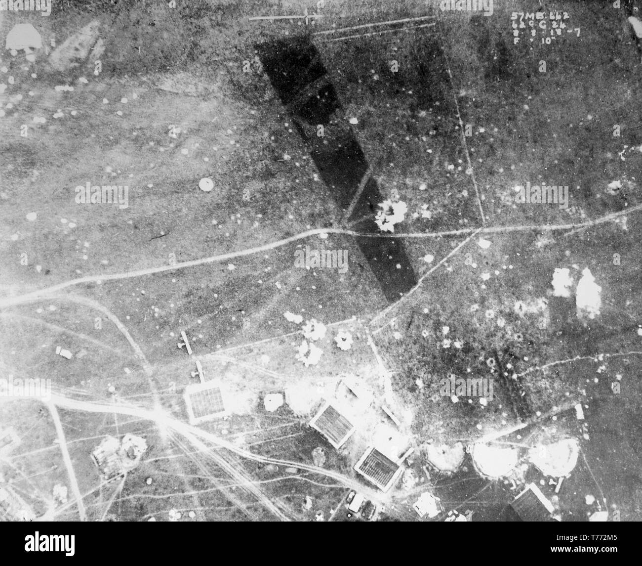 A contemporary British black and white aerial photograph taken on 8th August 1918, during  World War One, showing the destruction caused by the massive shelling and bombing of huge areas of Northern France. Two aeroplanes can be seen on the ground, as the aerodrome they are stationed in, has obviously been targeted for attack. - Stock Image