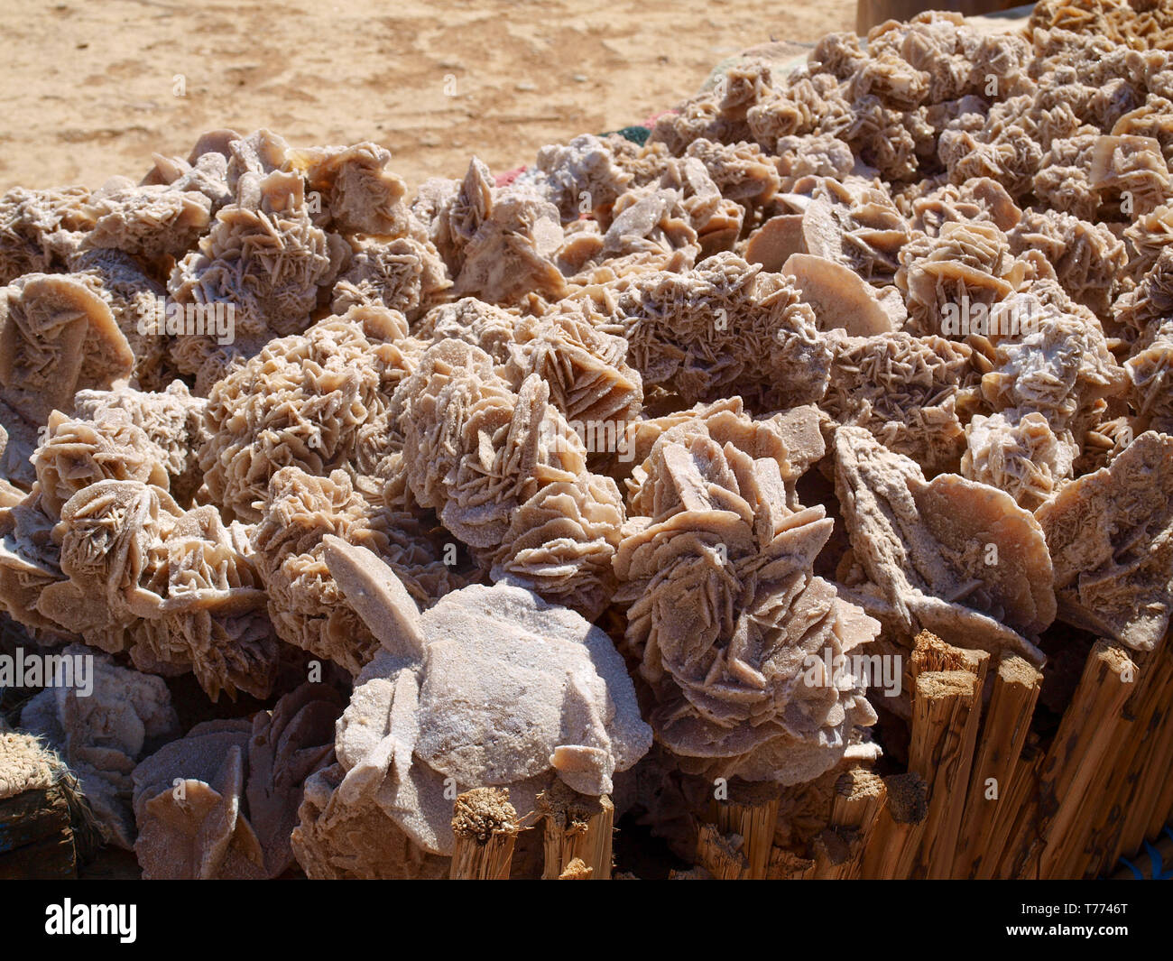 Desert roses, crystals made of the sand of Sahara and salt, Tunisian souvenirs - Stock Image