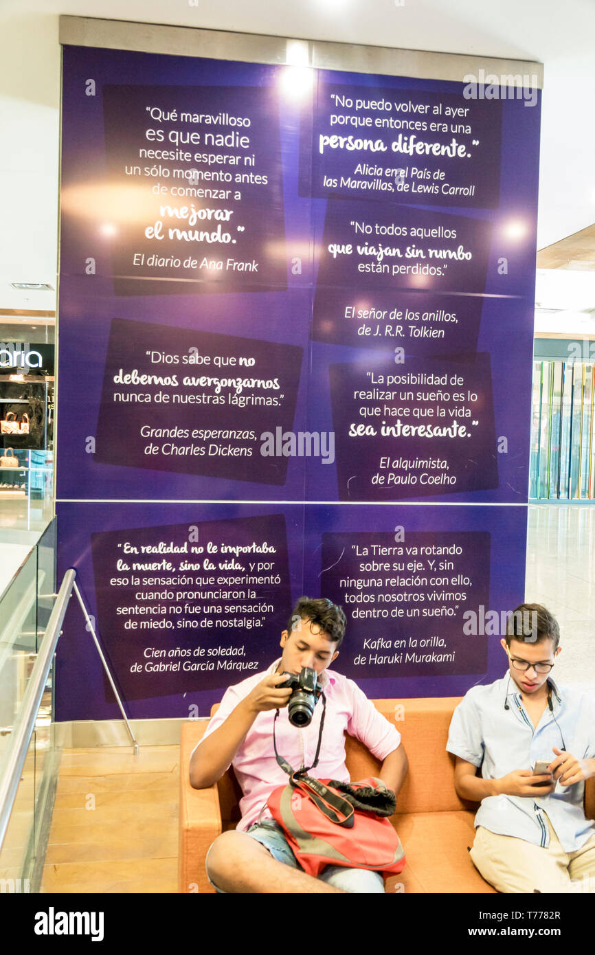 Cartagena Colombia Bocagrande Square Mall Plaza exterior sign vertical shopping center centre shopping seating area literary quotations Tolkien Dicken - Stock Image