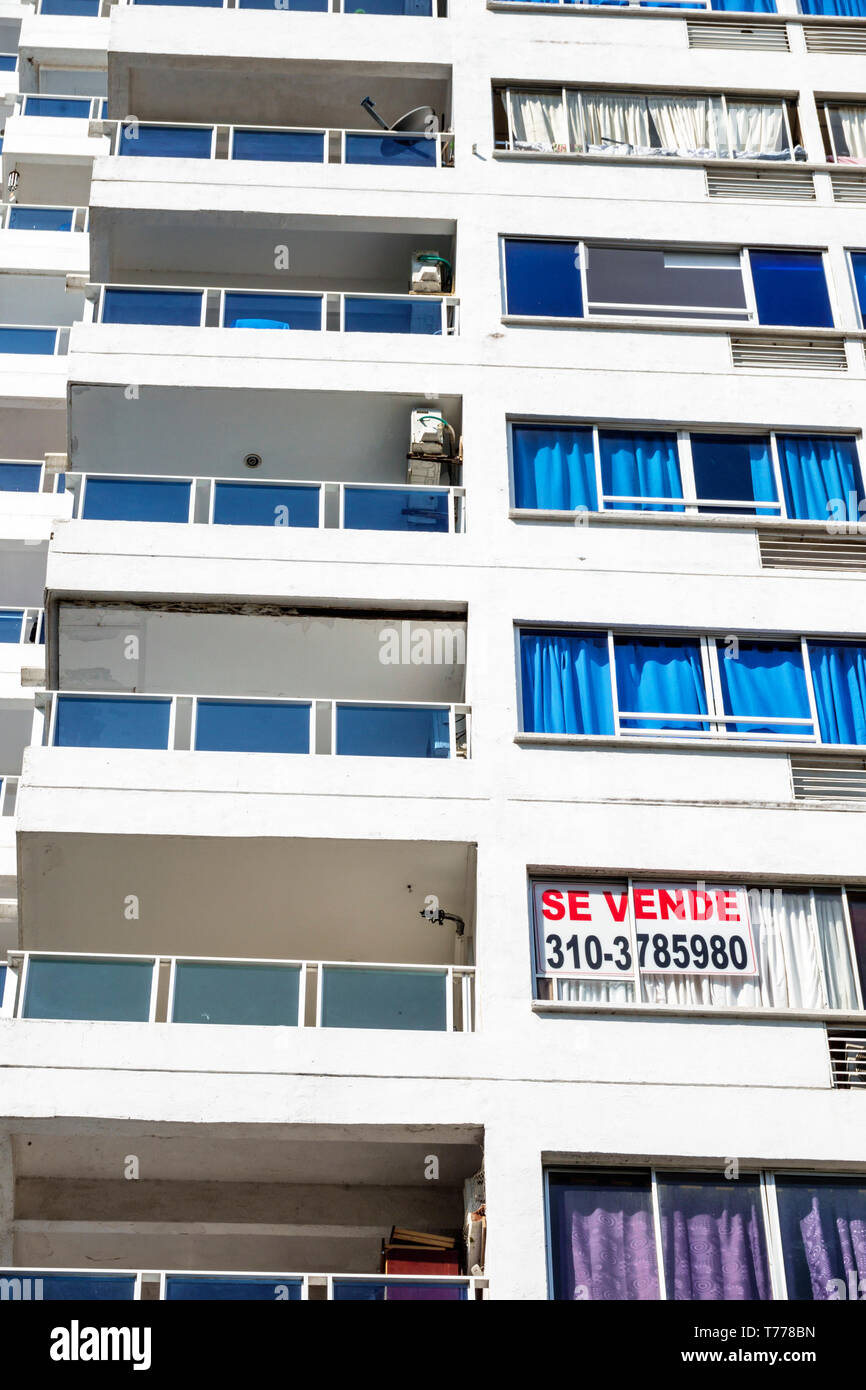 Cartagena Colombia El Laguito apartment building high rise condominium for sale sign Spanish language se vende balconies - Stock Image