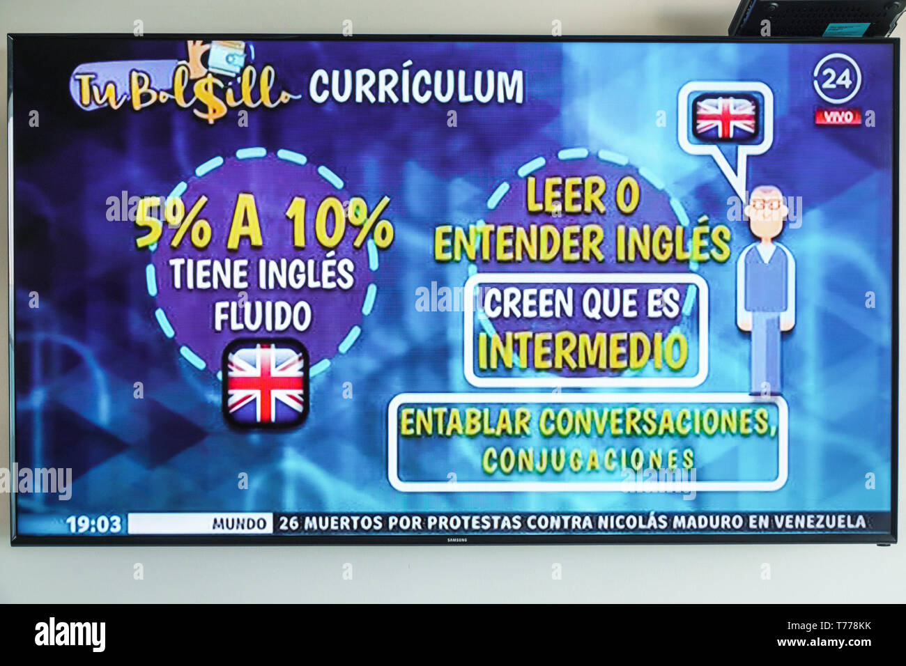 Cartagena Colombia TV television monitor screen flat screen Spanish language news demand for English speaker statistics Stock Photo