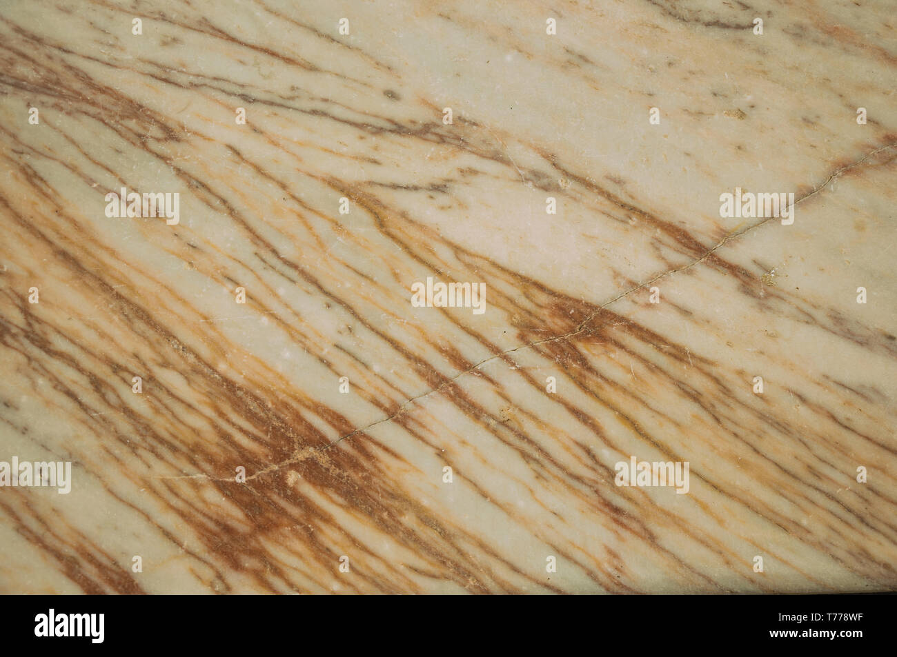 Close-up of old marble surface with veins and some cracks and chipped at Campo Maior. A town with medieval influences in eastern Portugal. Stock Photo
