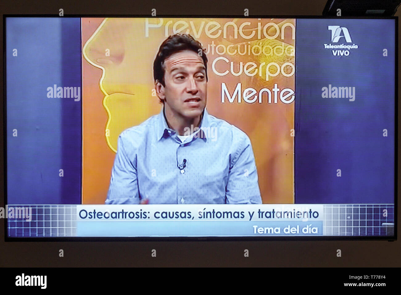 Cartagena Colombia TV television monitor screen flat screen medical program Spanish language osteoarthritis telemarketing Hispanic man - Stock Image