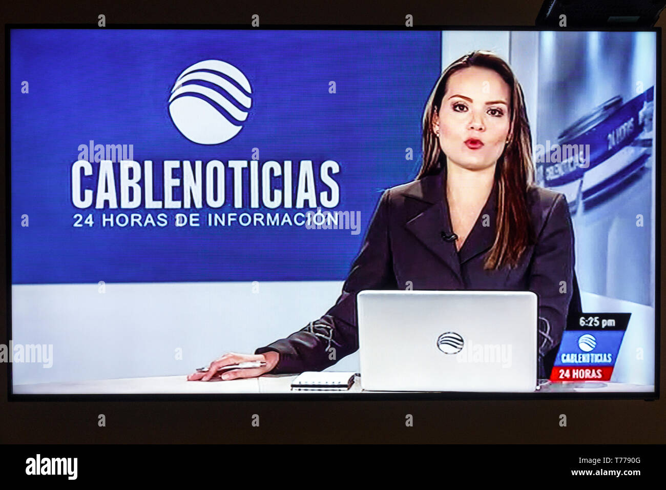 Cartagena Colombia TV television monitor screen flat screen cable news host Hispanic woman - Stock Image