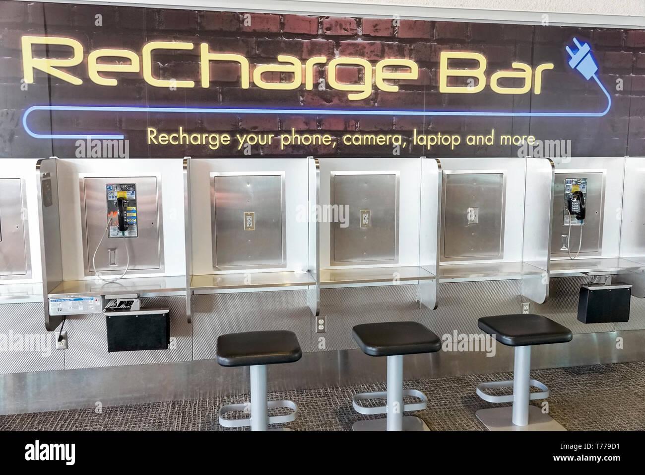 Miami Florida Miami International Airport MIA phone laptop battery recharge bar free convenience - Stock Image