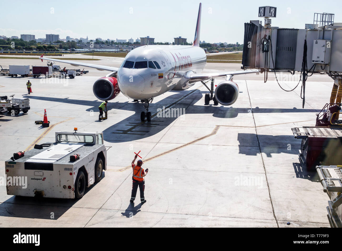 Miami Florida Miami International Airport MIA Avianca Airlines arriving jet airliner tarmac aircraft marshaller service area commercial airliner airpl - Stock Image