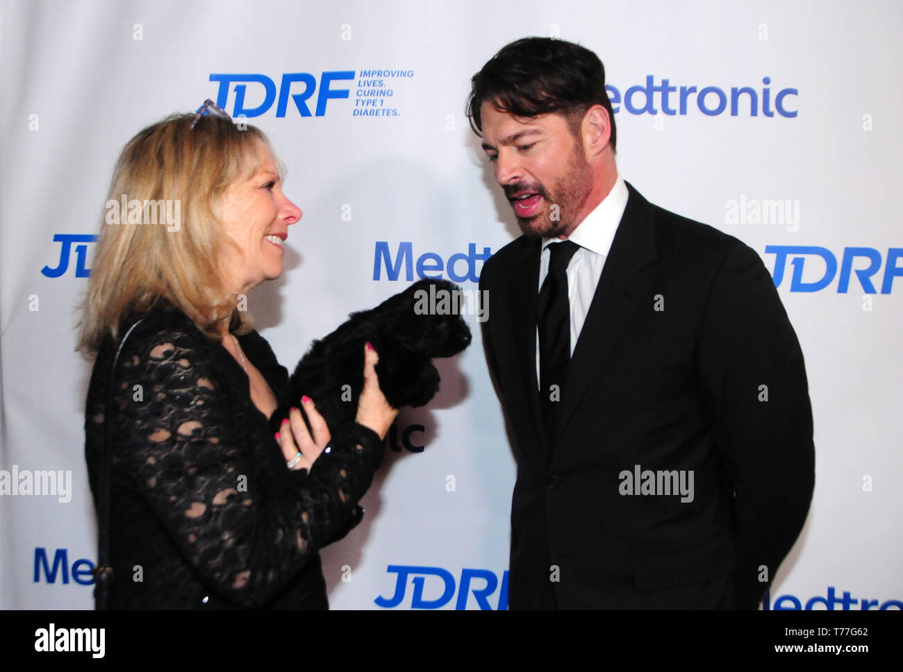 Beverly Hills, California, USA 4th May 2019  Publicist Cheri Warner, Puppy Olive and Singer Harry Connick Jr. attend JDRF Los Angeles Imagine Gala on May 4, 2019 at the Beverly Hilton Hotel in Beverly Hills, California, USA. Photo by Barry King/Alamy Live News - Stock Image