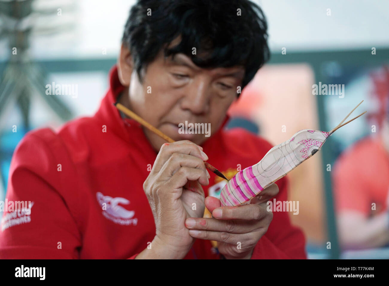 Beijing, China. 5th May, 2019. Wei Guoqiu, a respected Tianjin kite maker, shows his craft during the 'Tianjin Day' theme event held as part of the Beijing International Horticultural Exhibition in Yanqing District, Beijing, capital of China, May 5, 2019. Credit: Ju Huanzong/Xinhua/Alamy Live News - Stock Image