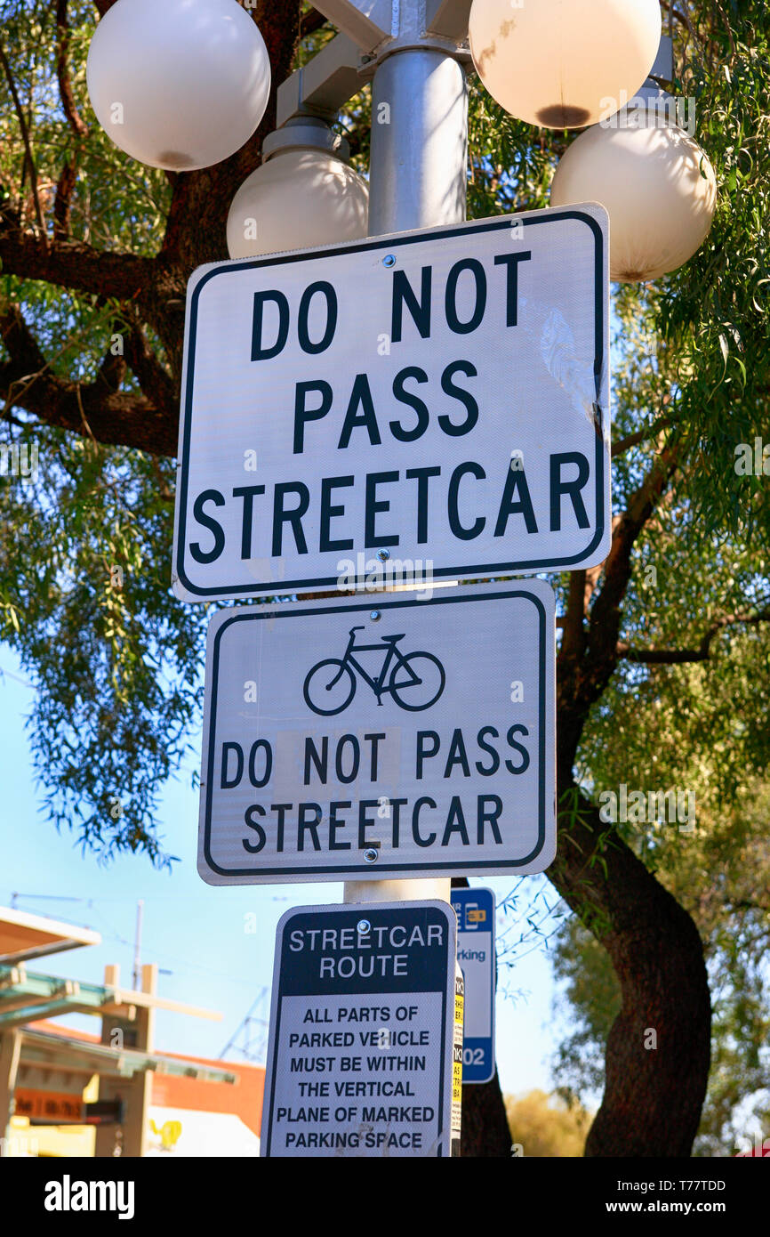 Black and white Street sign - Do Not Pass Streetcars seen on 4th Ave in Tucson AZ - Stock Image