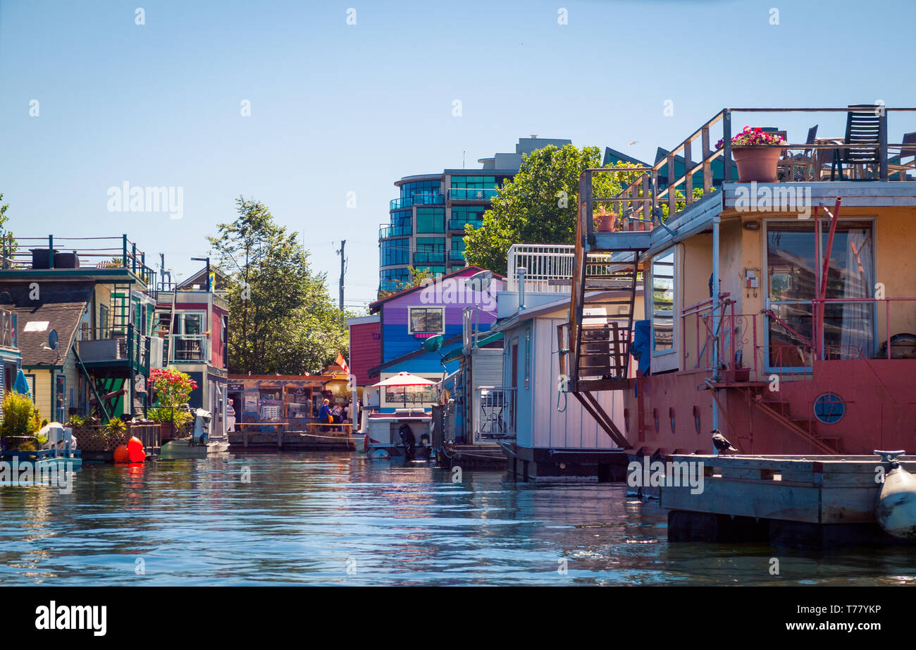 Quaint, floating houseboats in Fisherman's Wharf in Victoria, British Columbia, Canada. - Stock Image