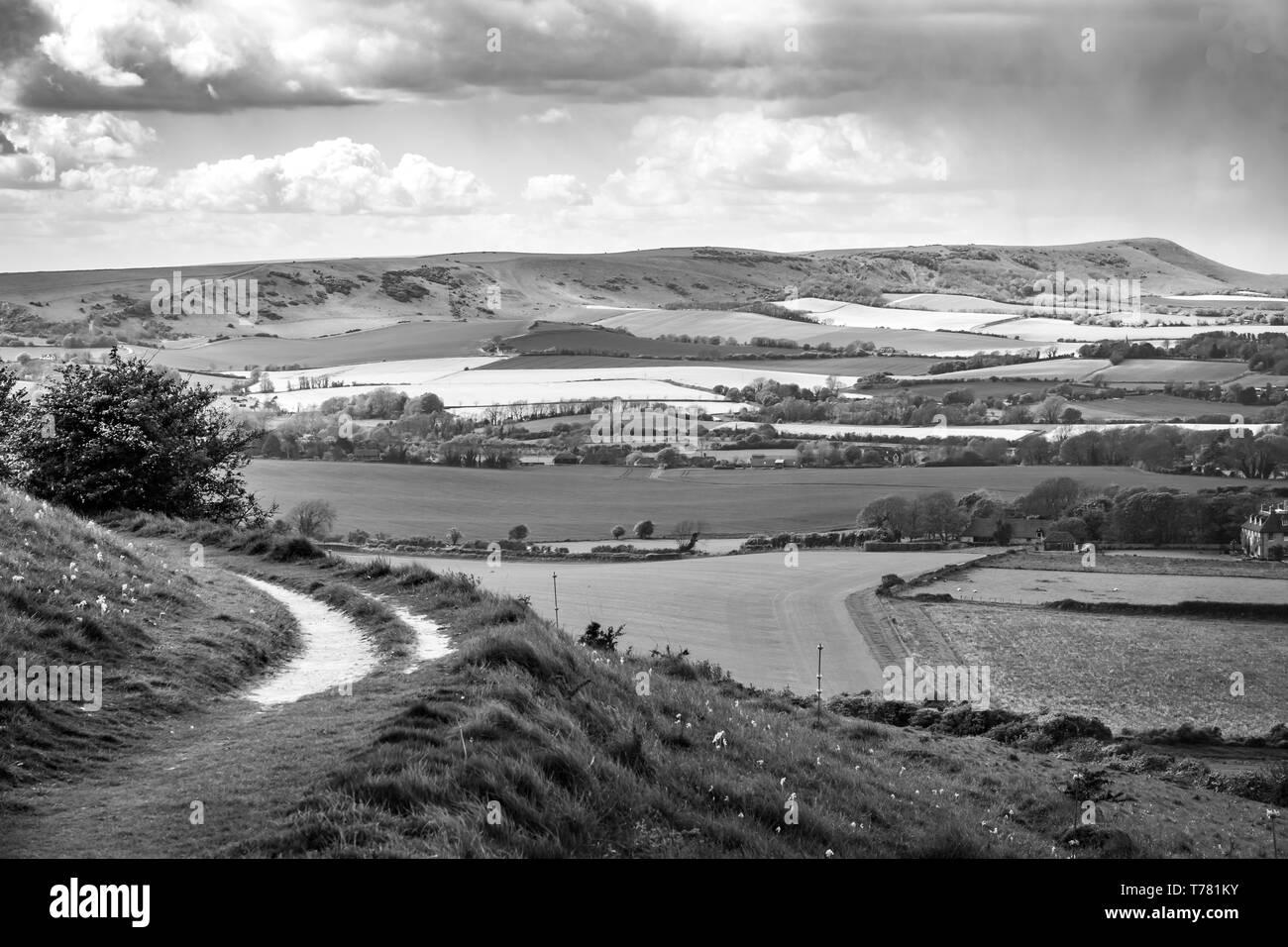 Track leading around downland hills - Stock Image