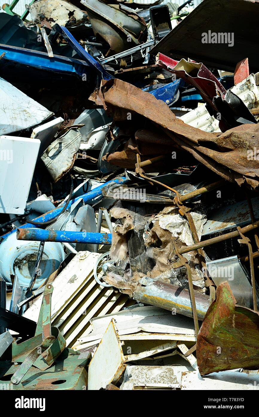 Scrap yard, scrap metal on waste dump in a recycling company - Stock Image