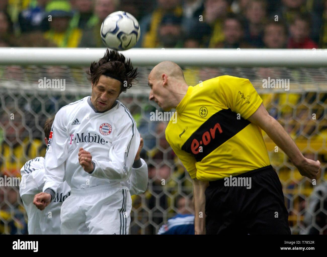 Westfalenstadion Dortmund Germany, 19.4.2003, German Football Bundesliga Season 2002/03, matchday 29, Borussia Dortmund (yellow) vs Bayern Munich (white) --- Nico Kovac (FCB), Jan Koller (BVB) - Stock Image