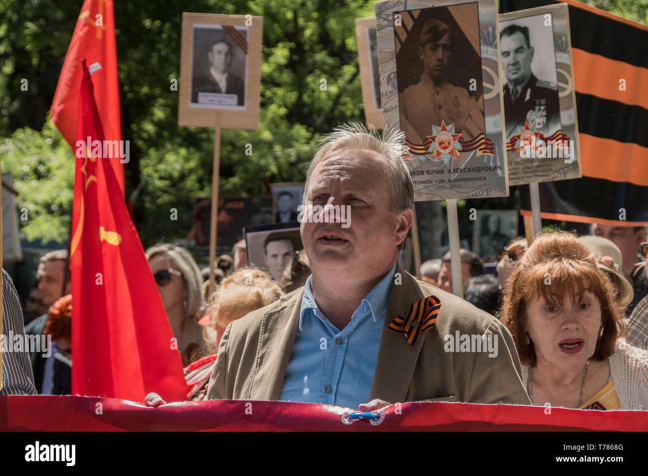 A man seen with in the celebration of the Soviet Union in its victory in the world war II in Madrid, Spain. celebration of the Soviet Union in its vic - Stock Image