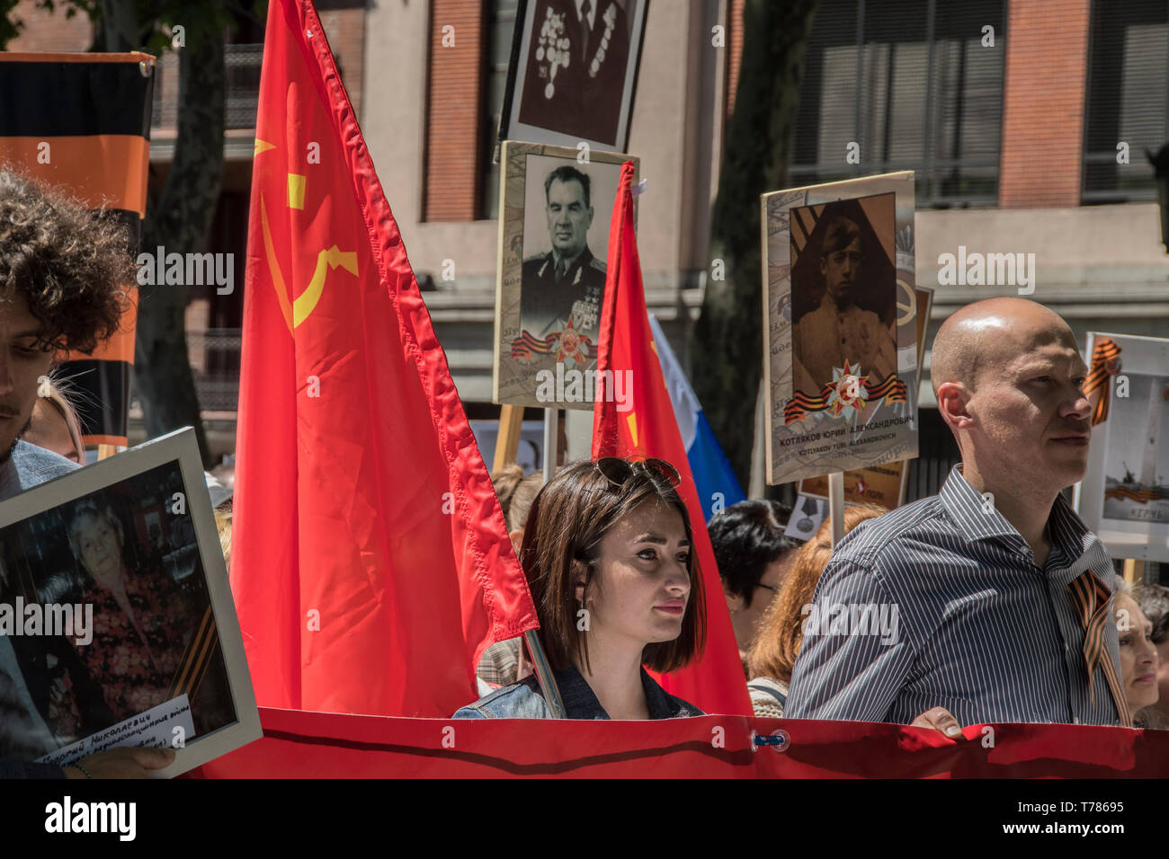 People seen with a flag of Soviet Union in the celebration of world war II, in prado avenue in Madrid, Spain. celebration of the Soviet Union in its v - Stock Image