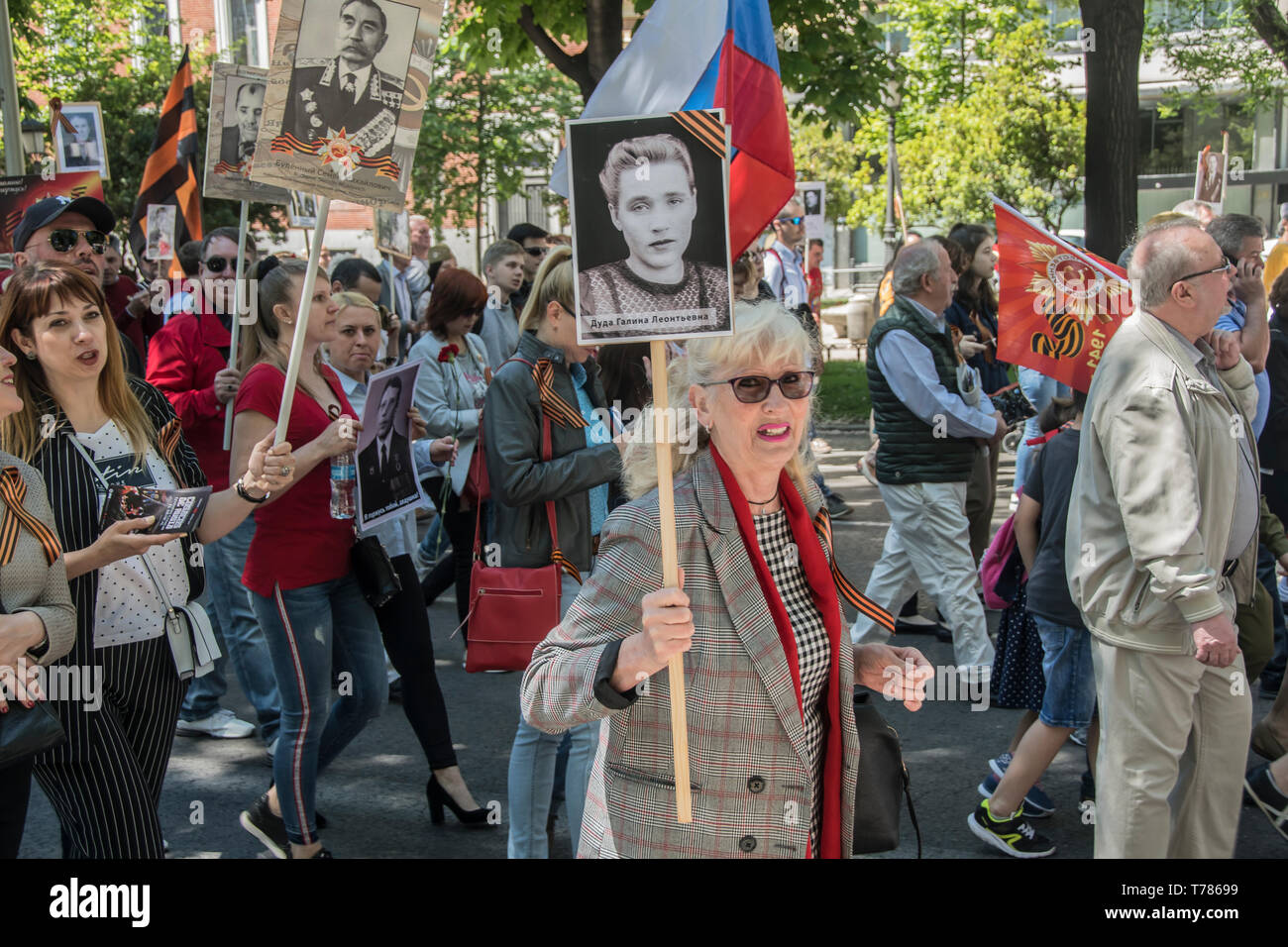 A woman seen with a picture of her grandfather who fight for soviet Union in the world war II. - Stock Image
