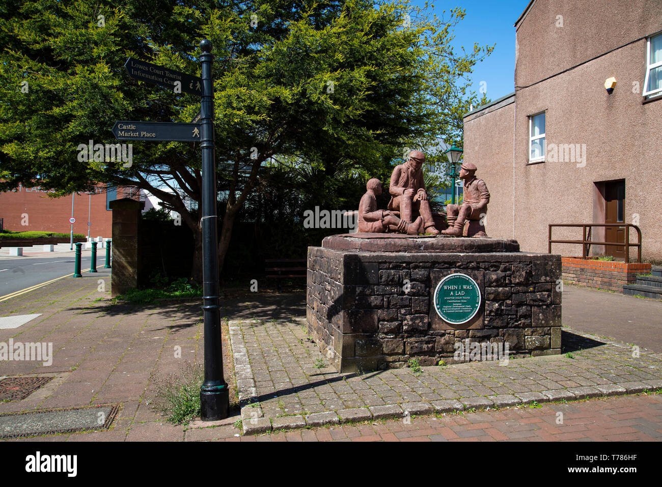 statue 'when I was a lad' by Colin Telfer at the entrance to westlakes academy which used to be Wyndham school in Egremont West Cumbria - Stock Image