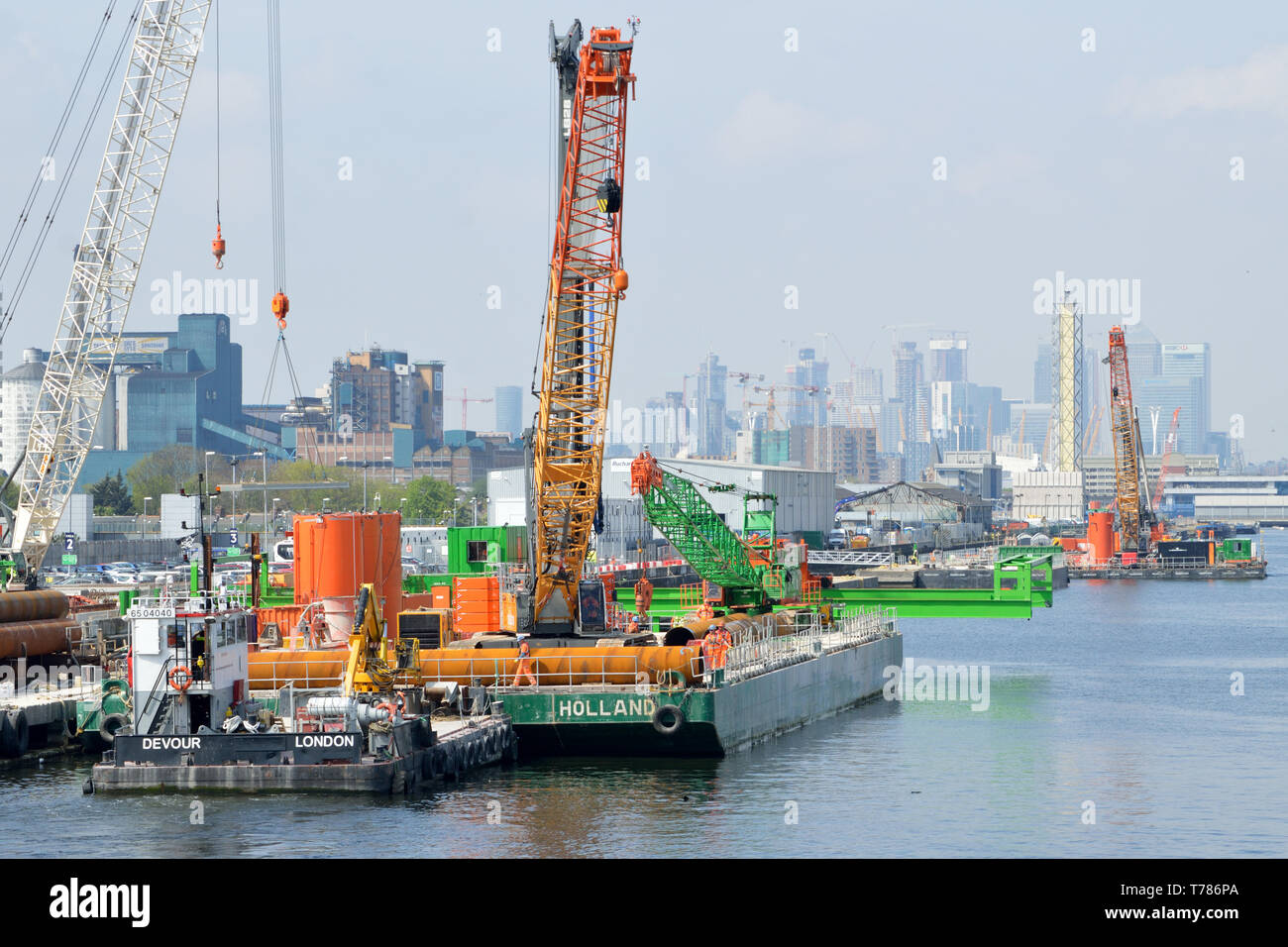 Tugs moving an engineering barge in the King George V Dock, London, as part of the London City Airport CADP expansion works Stock Photo
