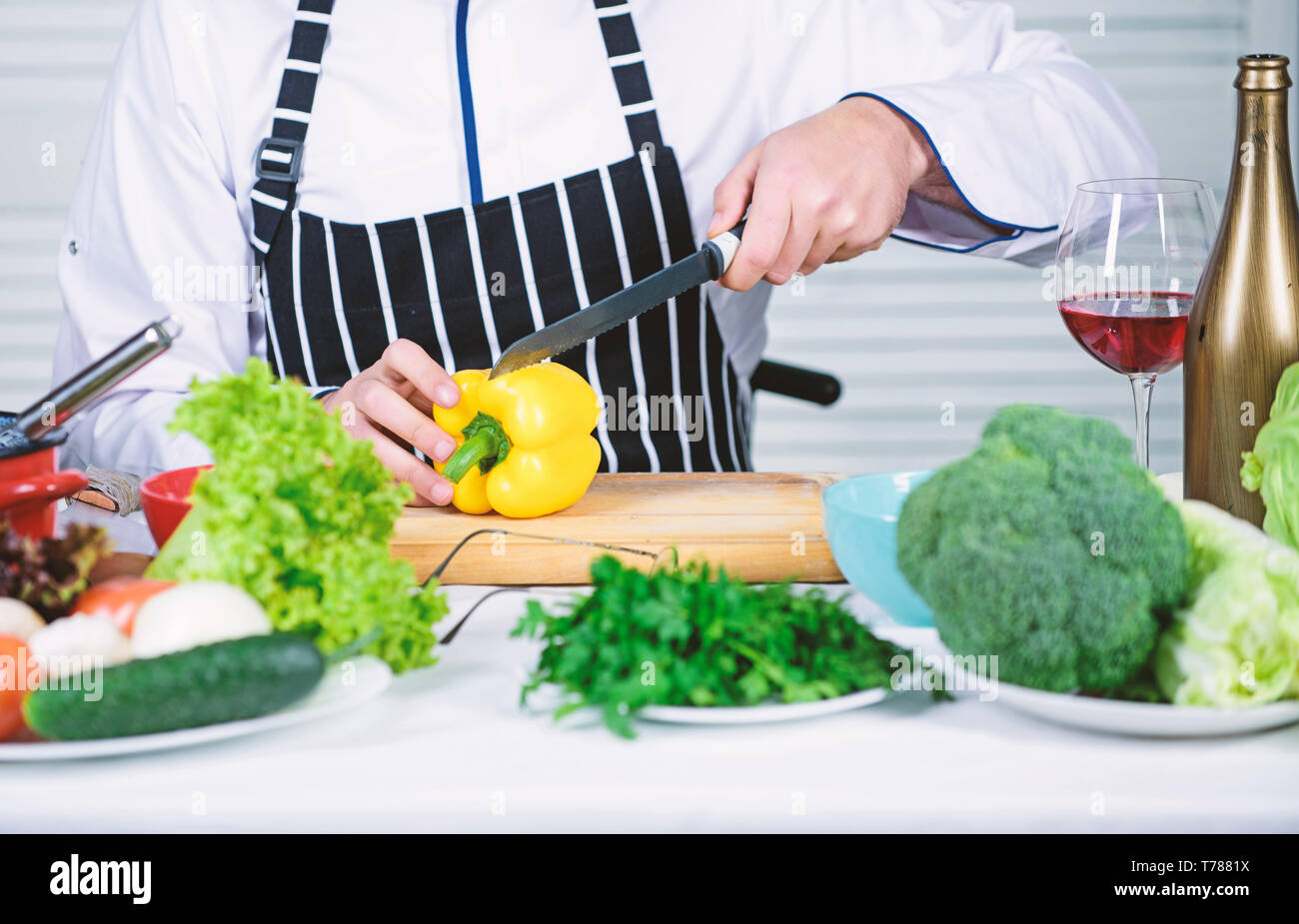 Prepare ingredients for cooking. Useful for significant amount of cooking methods. Basic cooking processes. Man master chef or amateur cooking healthy food. Chop ingredients. According to recipe. - Stock Image