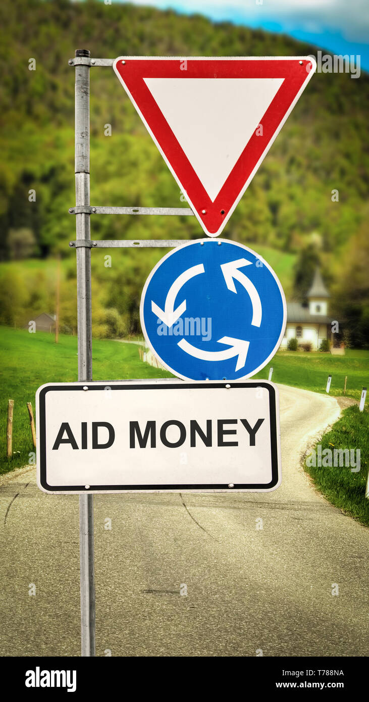 Street Sign the Direction Way to Aid Money - Stock Image