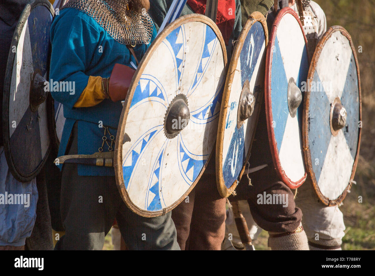 Group of slav warriors in reenactment battle rehearsal training, view on shieds - Stock Image
