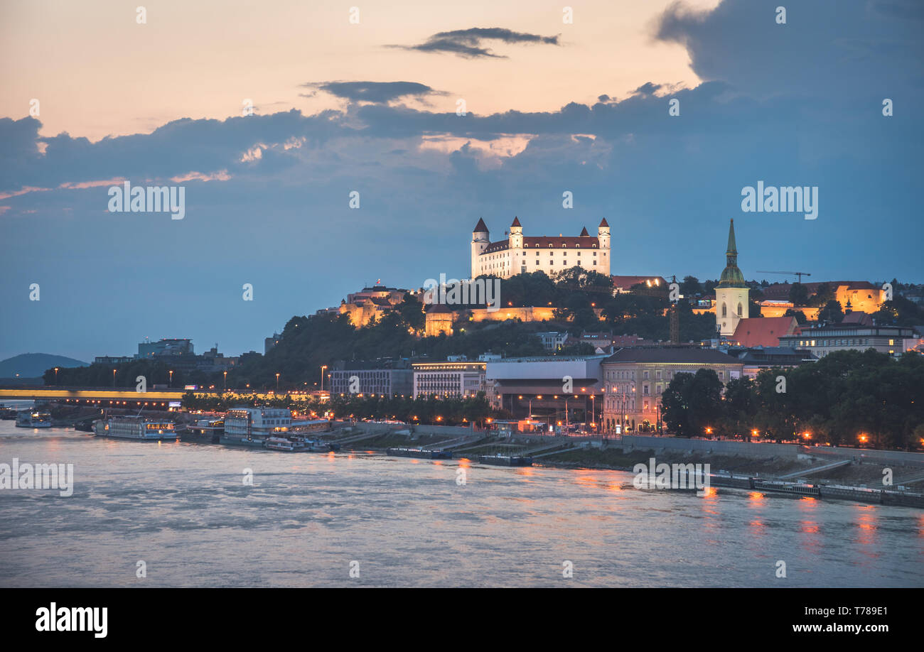Castle of Bratislava, Slovakia at Night as Seen from a Bridge over Danube River Towards Old Town of Bratislava. - Stock Image