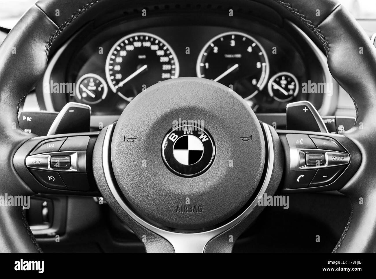 Sankt-Petersburg, Russia, March 05, 2017:  BMW X5M 2017, close up of steering wheel, dashboard modern car interior details. Black and white - Stock Image